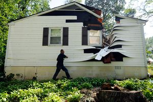 Home with giant split in roof opening down to main floor