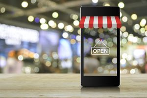 Modern smart mobile phone with on line shopping store graphic