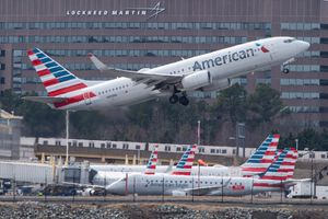 A Boeing 737 flown by American Airlines passes by the Lockheed Martin building