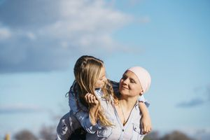 A woman with cancer is next to her daughter