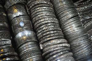 rows of silver bangles
