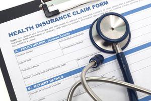 Stethoscope on health insurance form