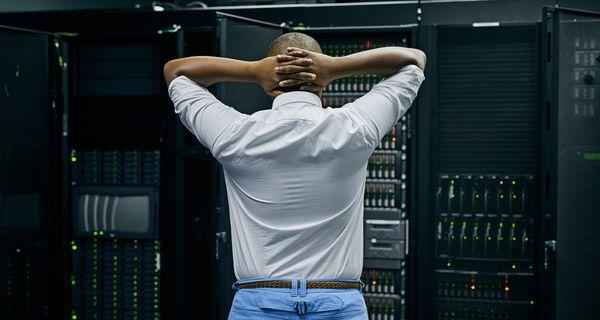 IT technician fixing data center problems