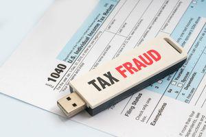 A USB key that says Tax Fraud on a 1040