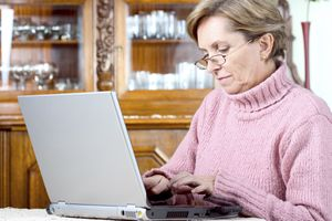 Woman sitting at her desk with laptop