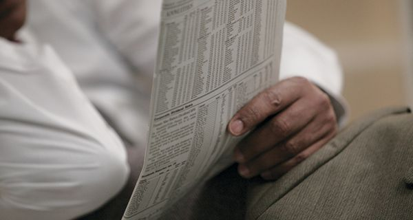 Image of person reading newspaper