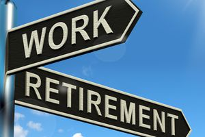Signpost showing work as one arrow, retirement as the other