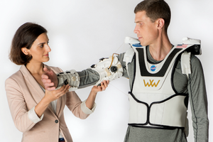 """The Soft Wearable Upper Extremity Garment, or """"Armstrong,"""" as modeled on the upper body. It activates the shoulder and elbow joints using a Bowden cable transmission system."""