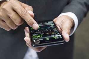 Manager buying cryptocurrency through mobile phone app