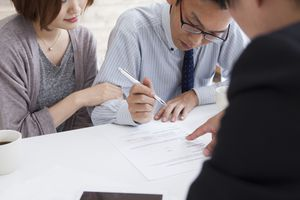 Couple signing a real estate contract