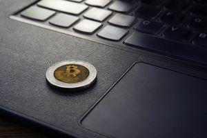 A bitcoin token on a laptop