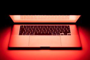 apple macbook laptop in red light