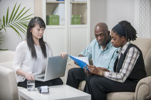 Couple reviewing a document with attorney