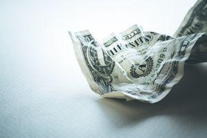 A crumpled up dollar bill