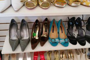 Shelves of stylish high heeled shoes, courtesy of Bargain Hunters Thrift Store