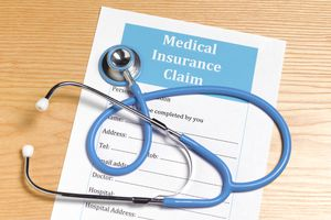 Medical Insurance Claim form and stethescope