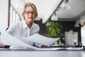 Businessperson reviews documents in an office