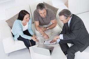 Couple talking to a salesperson about annuities.