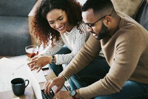 A couple looks over their FHA loan offer.