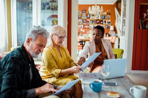 Financial advisor helps retirees review paperwork