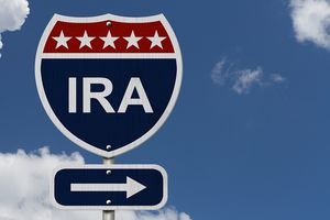 Road sign that says IRA with 5 stars and an arrow