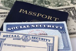A Social Security Cards, a Dollar Bill and a Passport