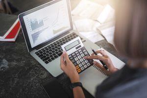 A business woman analyzing financial data.