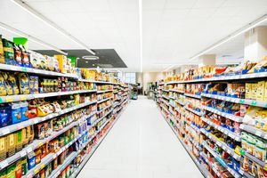 An Empty Supermarket Aisle Filled With Stock
