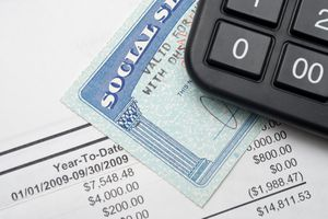 A calculator, Social Security card, and financial statement