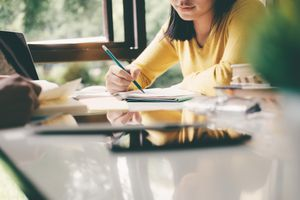 woman at desk studying
