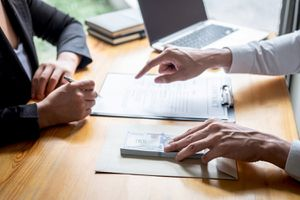 Cropped Hands of Businessman Bribing Female Coworker Signing Contract in Office
