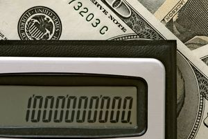 United States dollars and a calculator showing 1,000,000,000.