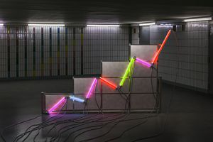 A graph made of neon tubes in a room