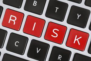 A risk word on a computer keyboard keys.