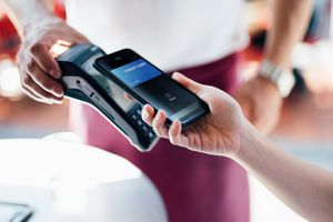 Paying with a mobile phone on a card reader.