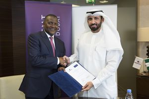 Al Sahibani (right), and Aliko Dangote (left) seal the acquisition of Dangote Cement by ICD in 2014