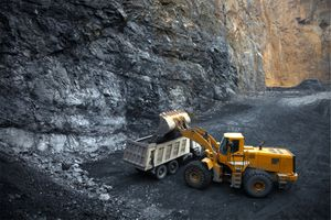 Mining bulldozer in cave