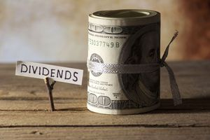Image of dividend sign and money roll