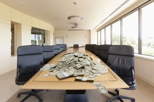 A pile of dollars on conference table.