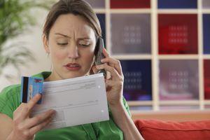 Woman looking at credit report