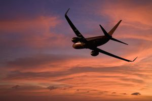 Boeing 737 flying into the sunset