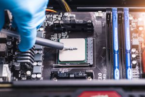 technician inserting chip into computer