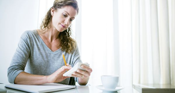 Woman calculating cost of insurance