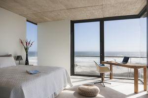 Modern bedroom overlooking ocean.