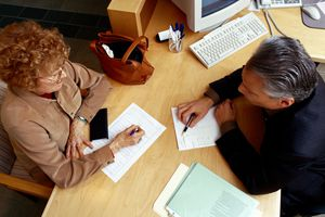 Advisor Assisting Woman with Paperwork