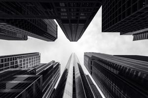 black and white looking up at Chicago's skyscrapers