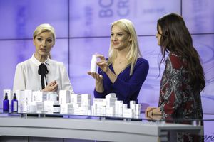 Three women talking about cosmetics on a TV infomercial