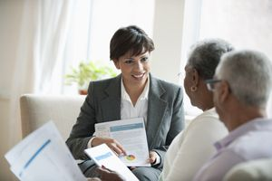 A financial advisor meets with clients to discuss retirement plans