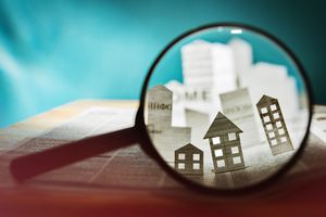 Paper building under a magnifying lens