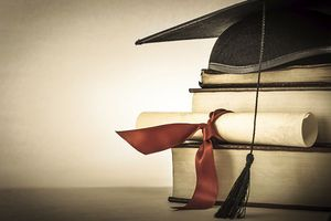Mortarboard, diploma, books